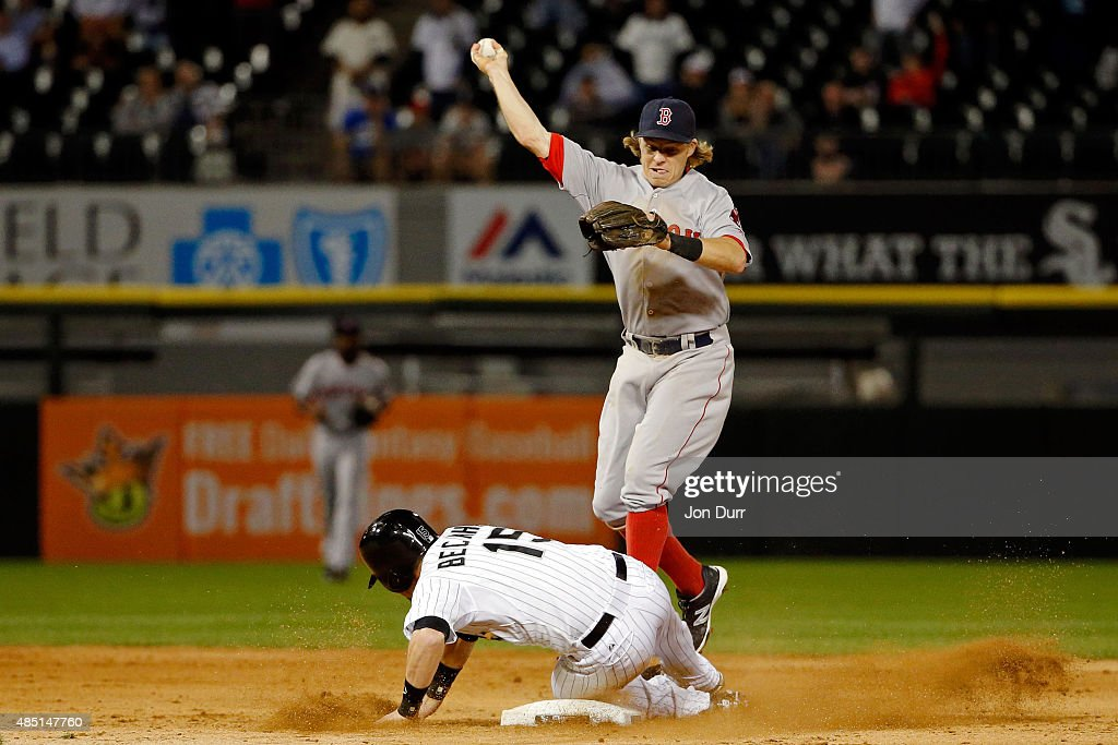 Brock Holt #26 of the Boston Red Sox throws to first base after forcing out Gordon Beckham #15 of the Chicago White Sox at second base during the ninth inning at U.S. Cellular Field on August 24, 2015 in Chicago, Illinois.