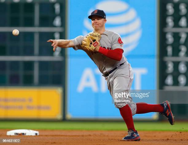 Brock Holt of the Boston Red Sox throws to first base to retire George Springer of the Houston Astros in the first inning at Minute Maid Park on May...