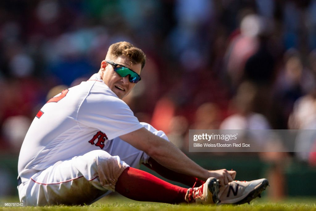 Brock Holt #12 of the Boston Red Sox ties his shoe during the eighth inning of a game against the Toronto Blue Jays on May 30, 2018 at Fenway Park in Boston, Massachusetts.
