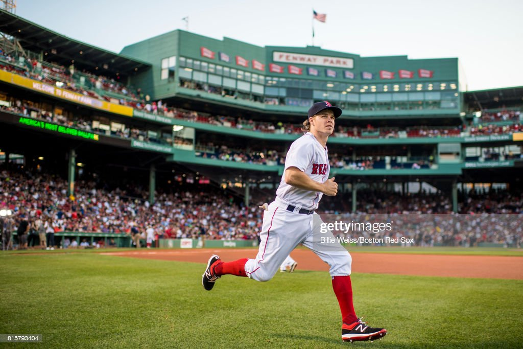 Brock Holt #12 of the Boston Red Sox warms up before a game against the New York Yankees on July 16, 2017 at Fenway Park in Boston, Massachusetts.