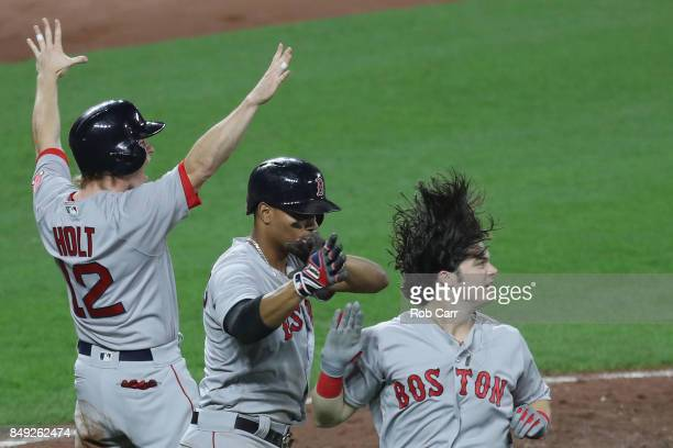 Brock Holt Xander Bogaerts and Andrew Benintendi of the Boston Red Sox celebrate after scoring against the Baltimore Orioles in the fifth inning at...