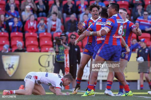 Brock Lamb of the Knights celebrates his try with team mates during the round 21 NRL match between the Newcastle Knights and the St George Illawarra...