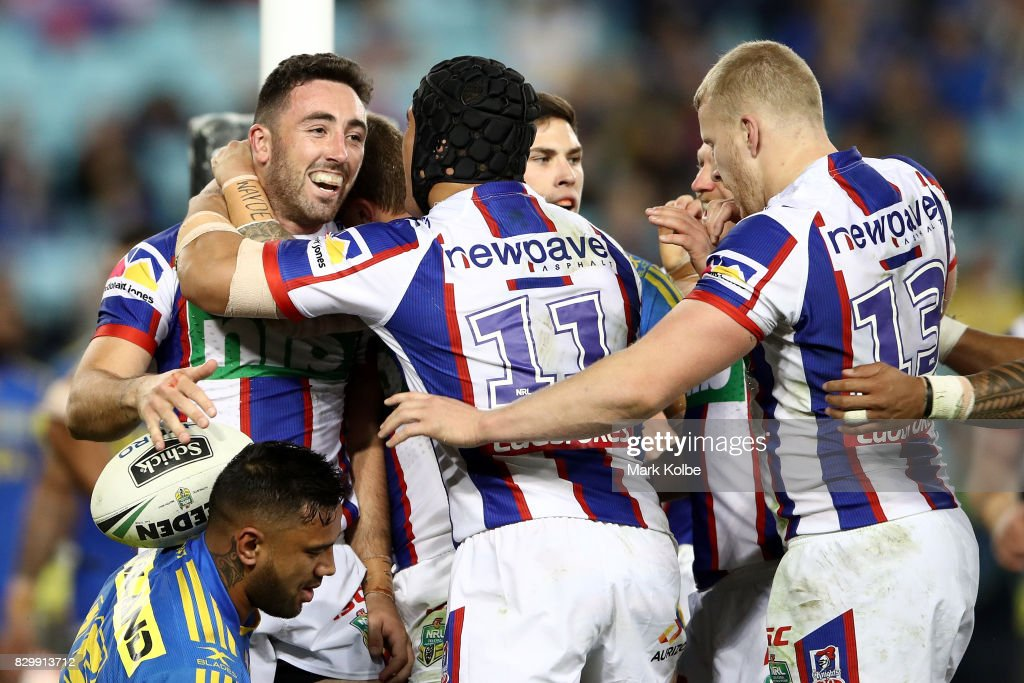 Brock Lamb of the Knights celebrates scoring a try with team mates during the round 23 NRL match between the Parramatta Eels and the Newcastle Knights at ANZ Stadium on August 11, 2017 in Sydney, Australia.