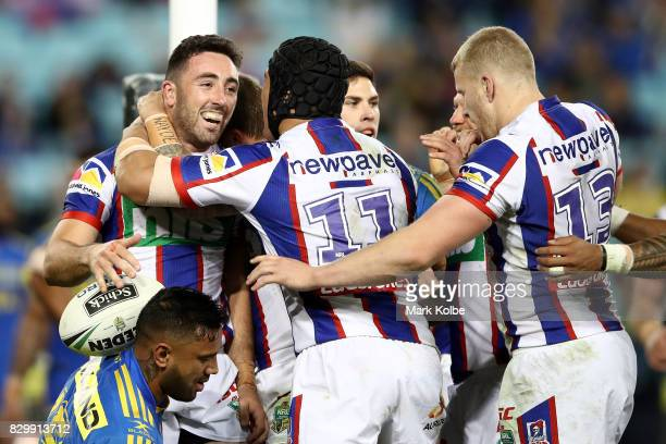 Brock Lamb of the Knights celebrates scoring a try with team mates during the round 23 NRL match between the Parramatta Eels and the Newcastle...