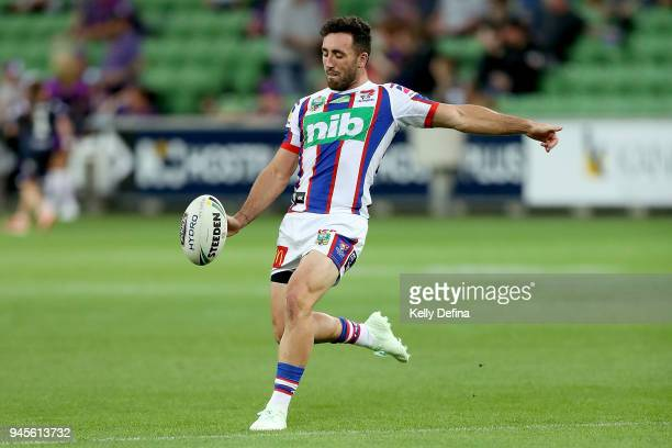 Brock Lamb of the Knights kicks the ball while warming up prior to the round six NRL match between the Melbourne Storm and the Newcastle Knights at...