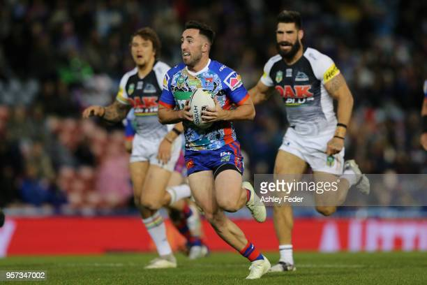 Brock Lamb of the Knights runs the ball during the round 10 NRL match between the Newcastle Knights and the Penrith Panthers at McDonald Jones...