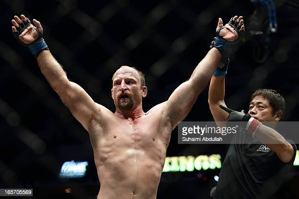 Brock Larson of United States of America celebrates victory over Melvin Manhoef of Netherlands during the One Fighting Championship at Singapore...