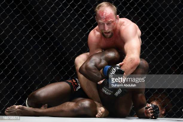 Brock Larson of United States of America fights Melvin Manhoef of Netherlands during the One Fighting Championship at Singapore Indoor Stadium on...