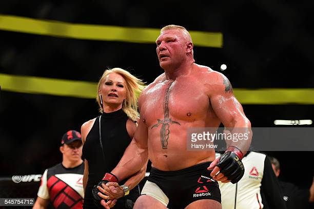 Brock Lesnar and his wife Rena Lesnar after Lesnar's victory over Mark Hunt of New Zealand in their heavyweight bout during the UFC 200 event on July...