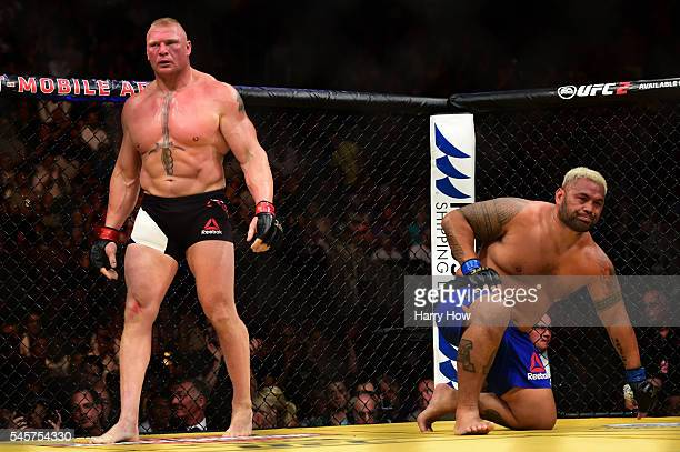 Brock Lesnar and Mark Hunt of New Zealand return to their corners after round one in their heavyweight bout during the UFC 200 event on July 9 2016...