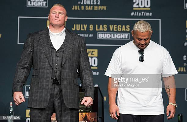Brock Lesnar and Mark Hunt pose for a picture during the UFC 200 Press Conference in KA Theater at MGM Grand Hotel Casino on July 6 2016 in Las Vegas...