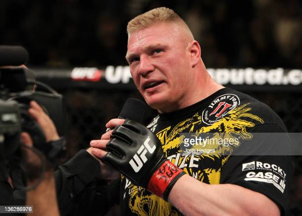 Brock Lesnar announces his retirement in the Octagon after losing to Alistair Overeem during the UFC 141 event at the MGM Grand Garden Arena on...