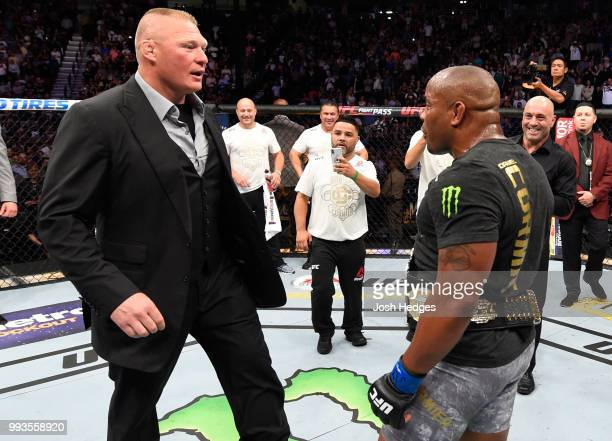 Brock Lesnar confronts Daniel Cormier after his UFC heavyweight championship fight during the UFC 226 event inside TMobile Arena on July 7 2018 in...
