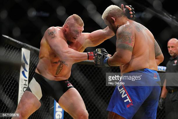 Brock Lesnar looks to take down Mark Hunt during the UFC 200 event at TMobile Arena on July 9 2016 in Las Vegas Nevada