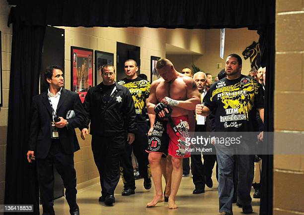 Brock Lesnar walks back to his locker room after announcing his retirement after his loss to Alistair Overeem during the UFC 141 event at the MGM...