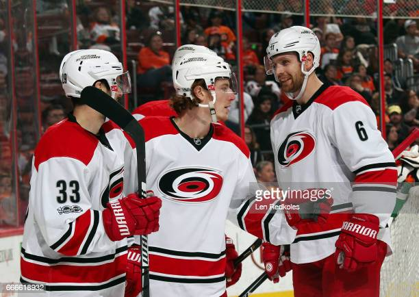 Brock McGinn of the Carolina Hurricanes celebrates his first period goal against the Philadelphia Flyers with Derek Ryan and Klas Dahlbeck on April 9...