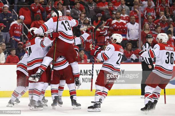 Brock McGinn of the Carolina Hurricanes celebrates his gamewinning goal with teammates against the Washington Capitals at 1105 of the second overime...