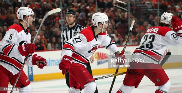 Brock McGinn of the Carolina Hurricanes celebrates his third period goal against the Philadelphia Flyers his second of the game with teammates Noah...