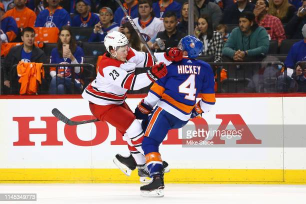 Brock McGinn of the Carolina Hurricanes gets tangled up with Thomas Hickey of the New York Islanders during Game One of the Eastern Conference Second...