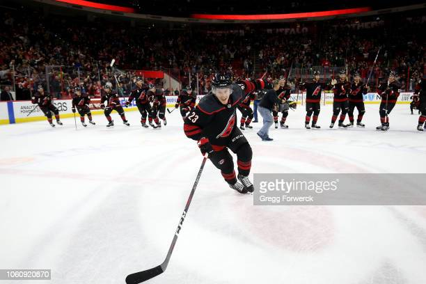 Brock McGinn of the Carolina Hurricanes leads the team in a celebration after their victory over the San Jose Sharks following an NHL game on October...