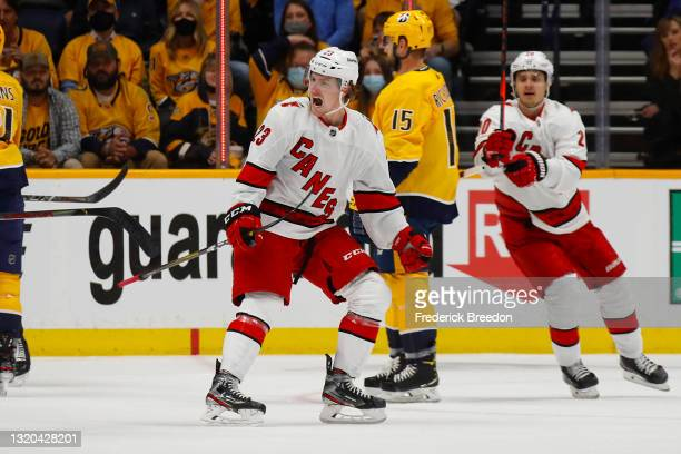 Brock McGinn of the Carolina Hurricanes reacts after scoring a goal against the Nashville Predators during the first period in Game Six of the First...