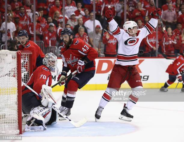 Brock McGinn of the Carolina Hurricanes scores the game winning goal against Braden Holtby of the Washington Capitals at 1105 of the second overime...