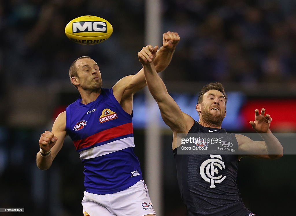 Brock McLean of the Blues and Daniel Cross of the Bulldogs compete for the ball during the round 20 AFL match between the Carlton Blues and the Western Bulldogs at Etihad Stadium on August 10, 2013 in Melbourne, Australia.