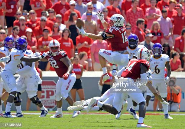 Brock Miller of the North Carolina State Wolfpack intercepts a pass intended for Deondre Farrier of the East Carolina Piratesduring the first half of...