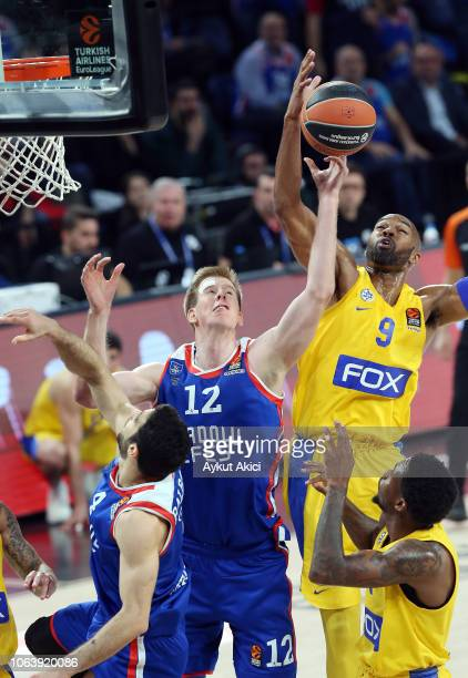 Brock Motum, #12 of Anadolu Efes Istanbul competes with Alex Tyus, #9 of Maccabi Fox Tel Aviv during the 2018/2019 Turkish Airlines EuroLeague...