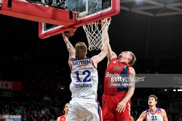 Brock Motum, #12 of Anadolu Efes Istanbul competes with Leon Radosevic, #10 of FC Bayern Munich during the 2018/2019 Turkish Airlines EuroLeague...