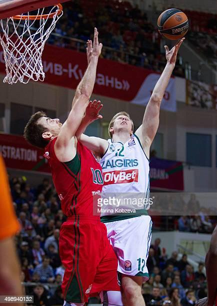 Brock Motum, #12 of Zalgiris Kaunas competes with Victor Claver, #9 of Lokomotiv Kuban Krasnodar during the Turkish Airlines Euroleague Regular...