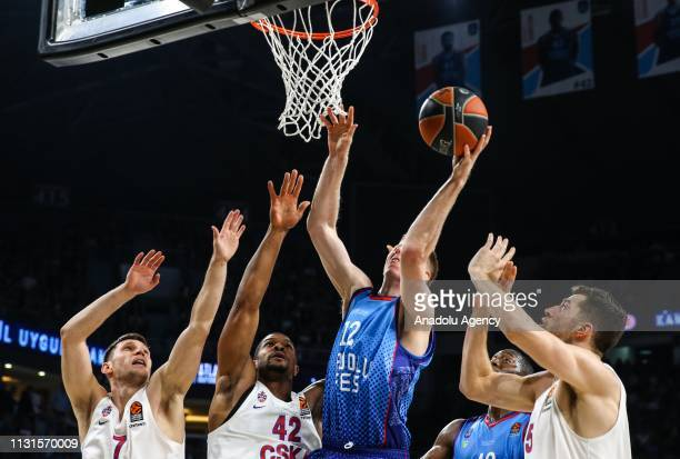 Brock Motum of Anadolu Efes in action against Ivan Ukhov Kyle Hines and Alec Peters of CSKA Moscow during the Turkish Airlines Euroleague week 27...