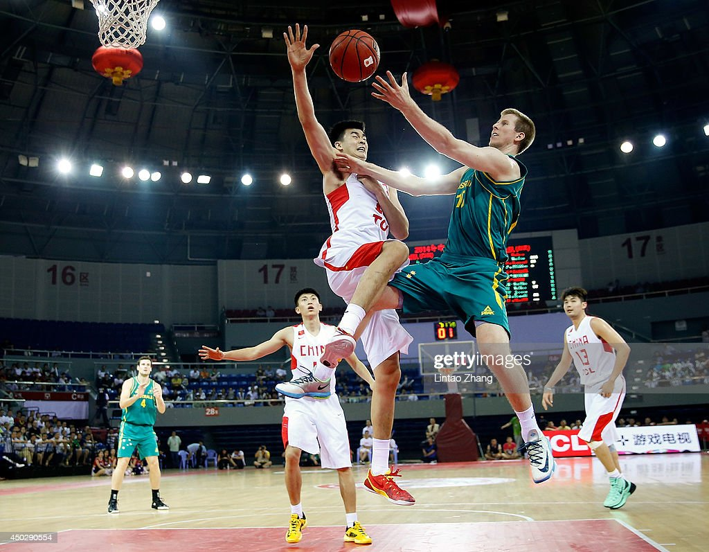 Brock Motum (R) of Australia drives to the basket against Li Muhao of china during the 2014 Sino-Australia Men's International Basketball Challenge match between the Australian Boomers and China at Liyang City Stadium on June 8, 2014 in Changzhou, China.