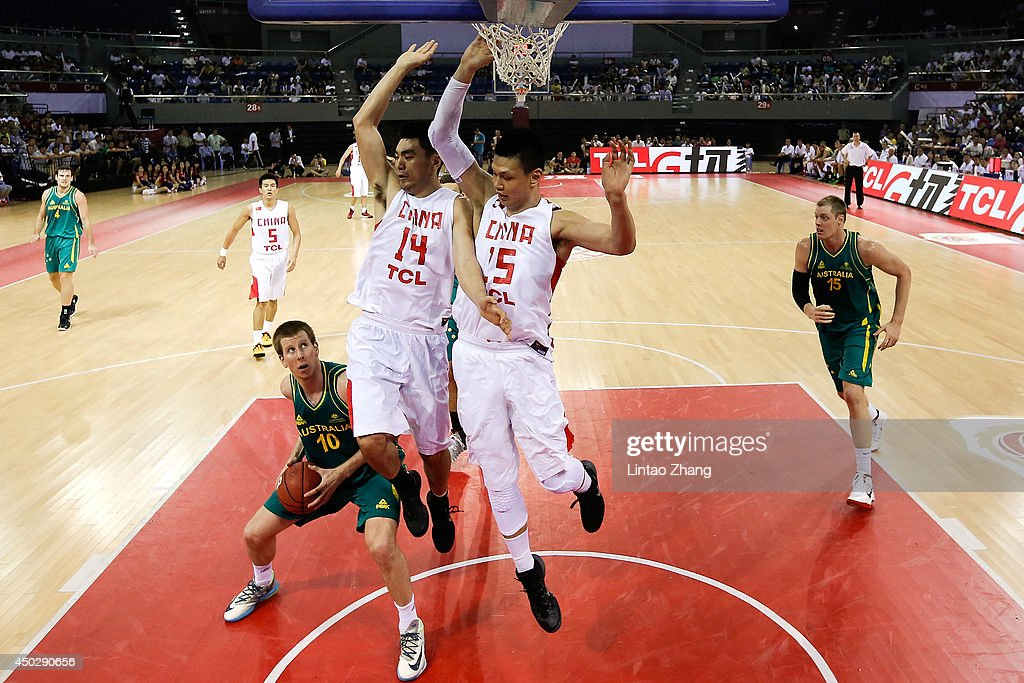 Brock Motum (R) of Australia drives to the basket against Li Xiaoxu and Xu Zhonghao of China during the 2014 Sino-Australia Men's International Basketball Challenge match between the Australian Boomers and China at Liyang City Stadium on June 8, 2014 in Changzhou, China.