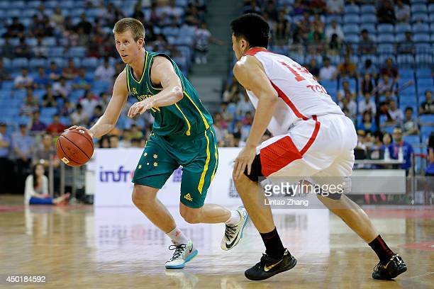 Brock Motum of Australia drives to the basket against Li Xiaoxu of China during the 2014 Sino-Australia Men's International Basketball Challenge...