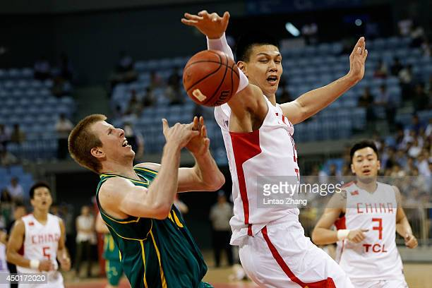 Brock Motum of Australia drives to the basket against Xu Zhonghao of China during the 2014 Sino-Australia Men's International Basketball Challenge...