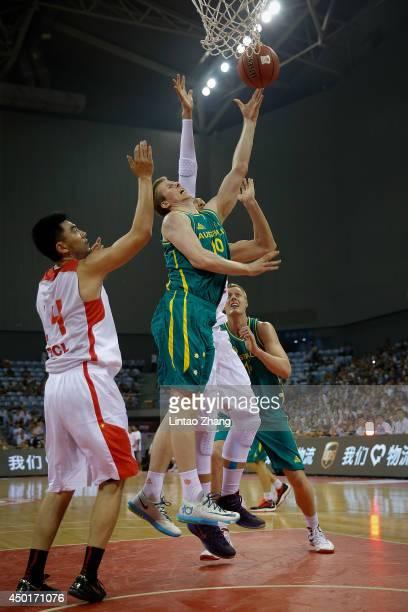 Brock Motum of Australia drives to the basket during the 2014 Sino-Australia Men's International Basketball Challenge match between the Australian...