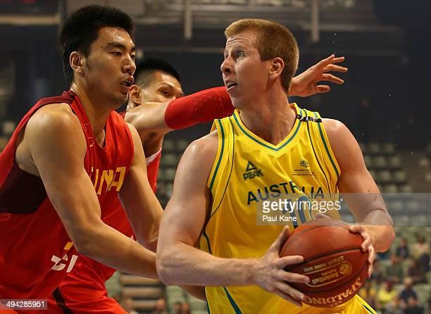 Brock Motum of Australia looks to drive to the basket against Xiaoxu Li of China during the 2014 Sino-Australia Challenge match between Australia and...