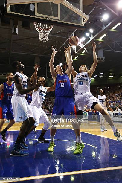 Brock Motum of the 36ers competes with Tom Abercrombie of the Breakers during game two of the NBL Finals series between the New Zealand Breakers and...