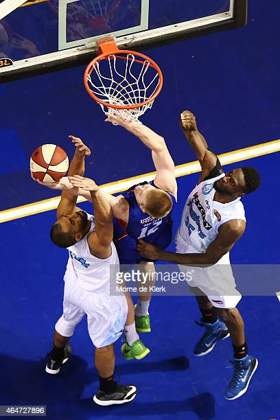 Brock Motum of the 36ers is blocked by Mika Vukona and Ekene Ibekwe of the Breakers during game two of the NBL Finals series between the New Zealand...