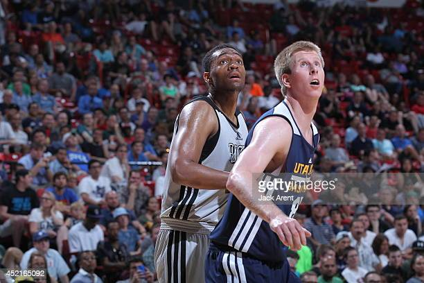 Brock Motum of the Utah Jazz boxes out against Jabari Parker of the Milwaukee Bucks at the Samsung NBA Summer League 2014 on July 14, 2014 at the...