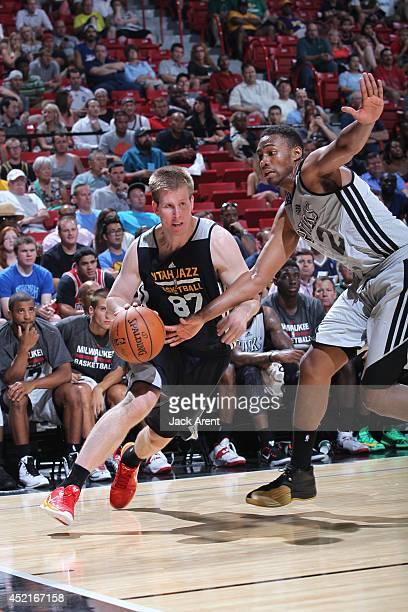 Brock Motum of the Utah Jazz drives against Jabari Parker of the Milwaukee Bucks at the Samsung NBA Summer League 2014 on July 14, 2014 at the Thomas...
