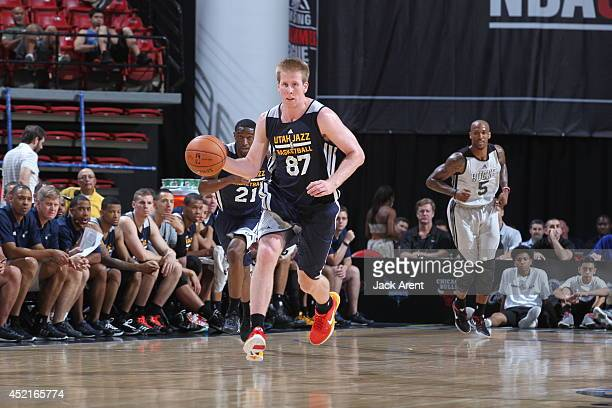 Brock Motum of the Utah Jazz drives against the Milwaukee Bucks at the Samsung NBA Summer League 2014 on July 14, 2014 at the Thomas & Mack Center in...