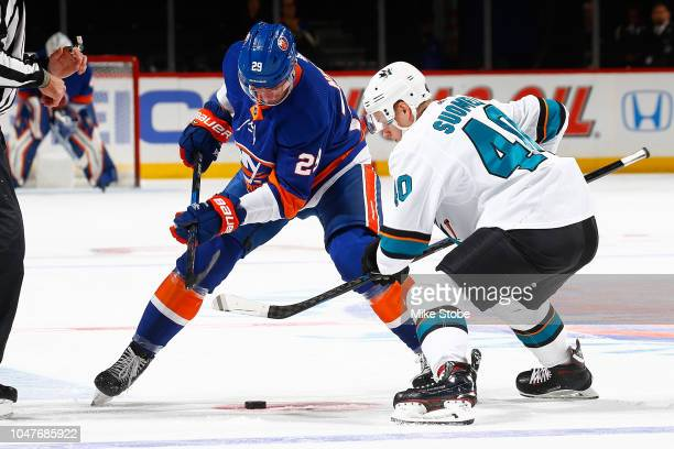 Brock Nelson of the New York Islanders and Antti Suomela of the San Jose Sharks faceoff during the first period at Barclays Center on October 8 2018...