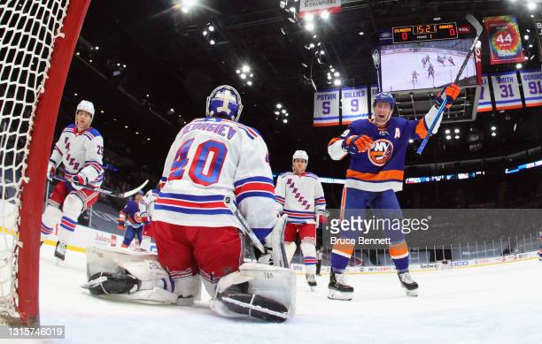 Brock Nelson of the New York Islanders celebrates a first period goal by Anthony Beauvillier against Alexandar Georgiev of the New York Rangers at...