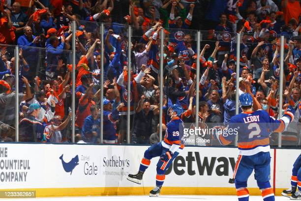 Brock Nelson of the New York Islanders celebrates after scoring a goal against the Boston Bruins as fans cheer during the second period in Game Six...