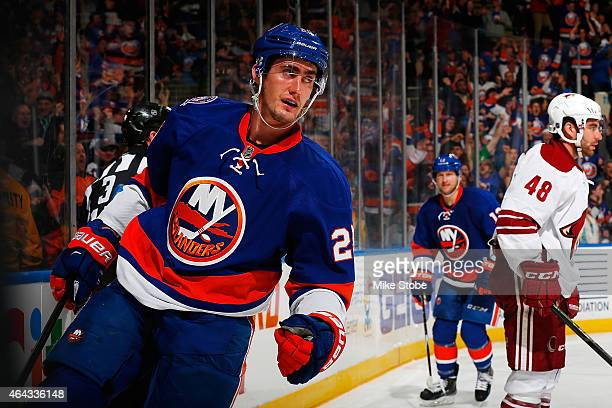 Brock Nelson of the New York Islanders celebrates after scoring a third period goal against the Arizona Coyotes at Nassau Veterans Memorial Coliseum...