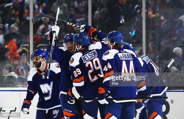 Brock Nelson of the New York Islanders celebrates his second period goal with the New York Rangers during the 2014 Coors Light NHL Stadium Series at...