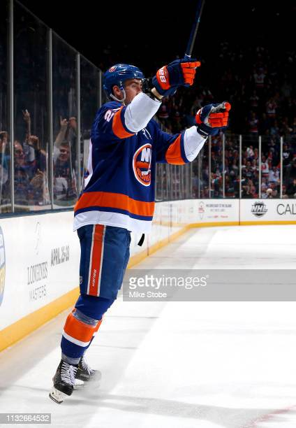 Brock Nelson of the New York Islanders celebrates his third period goal against the Arizona Coyotes at NYCB Live's Nassau Coliseum on March 24 2019...