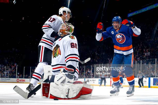 Brock Nelson of the New York Islanders celebrates the game winning goal in overtime by teammate Devon Toews to give his team the 32 win as Collin...